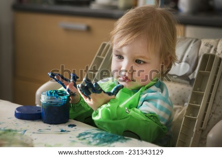 the child draws paints - stock photo