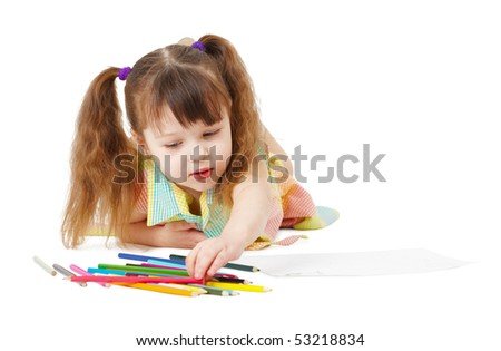 The child draws with color pencils on a white background