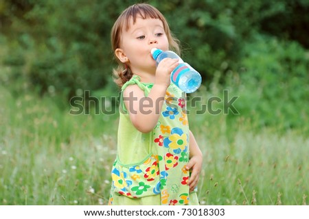 The child drinking water  - stock photo