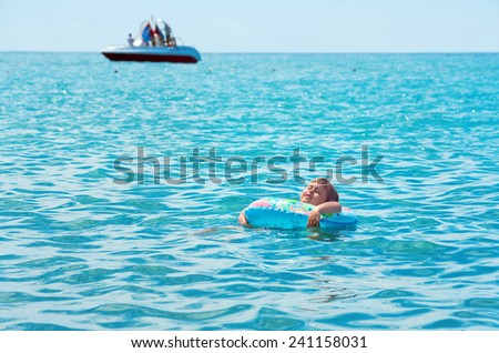The child enjoys bathing in the sea - stock photo