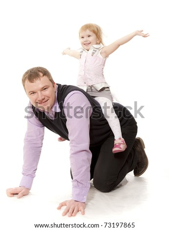 The child goes on a back of the man - stock photo