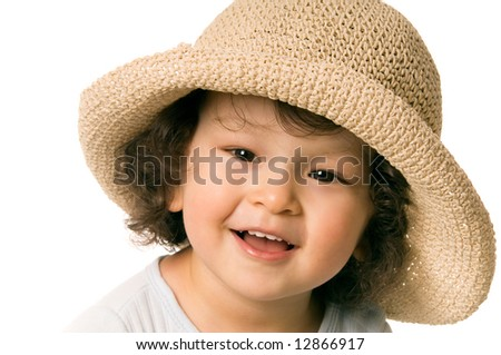 The child in a  straw-hat. - stock photo