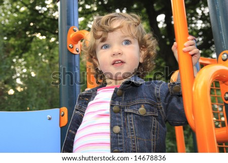 The child is having fun on the playground.