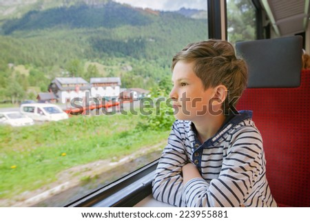 the child is traveling in a train - stock photo