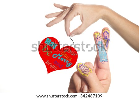 The Child Jesus, Virgin Mary and Saint Joseph drawn in one hand and heart with Christmas message isolated on white background - stock photo