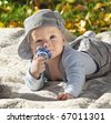 The child lies on a coverlet on the nature - stock photo