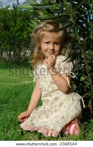 the child on grass - stock photo