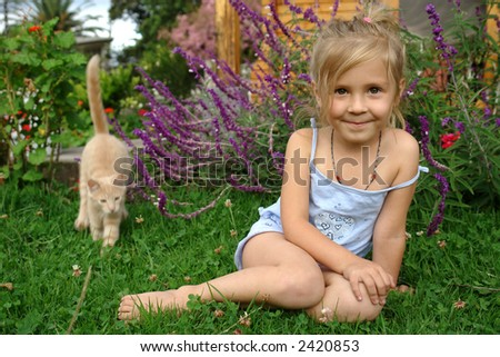 the child on the grass - stock photo