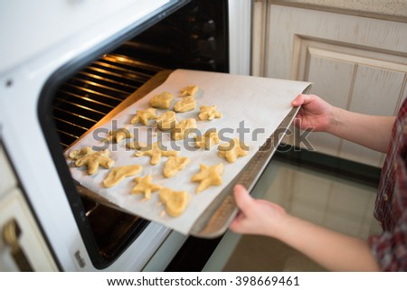 the child puts in the oven cookies, independent children,. casual lifestyle photo series in real life interior