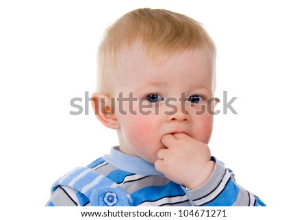 the child sits, hand in the mouth isolated on white background