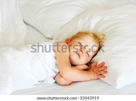 The child sleeps in bed - stock photo
