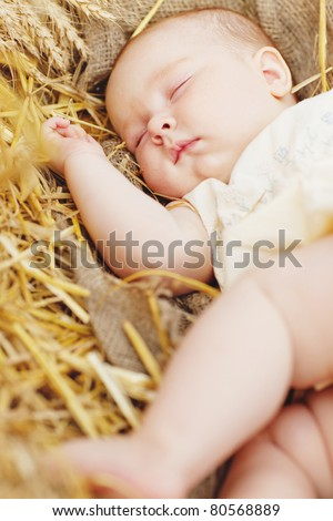 The child sleeps in nature. Infant.