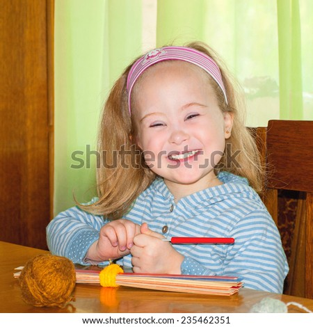 The child smiling, syndrome, down syndrome - stock photo