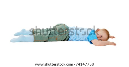 The child stumbled, fell and lay isolated on white background - stock photo