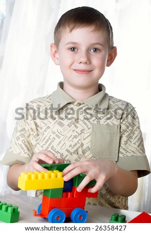 The child the boy plays - stock photo