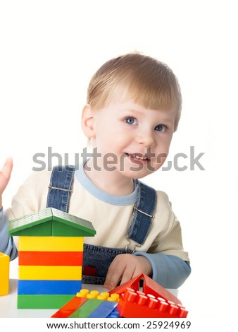 The child the boy plays cubes on a white background - stock photo