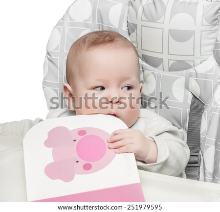The child took the book in a mouth on the white - stock photo
