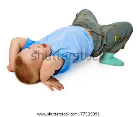 The child tries to do a gymnastic stance on the floor isolated on white background - stock photo