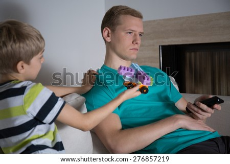 The child wants to play with blocks with his father - stock photo