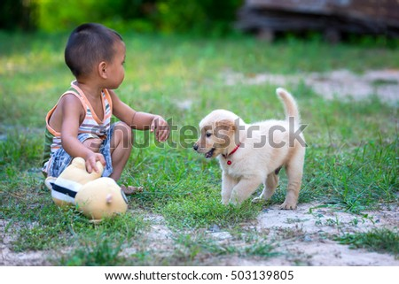 The child with a dog in blurry background