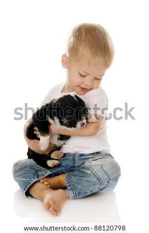 The child with a puppy - stock photo