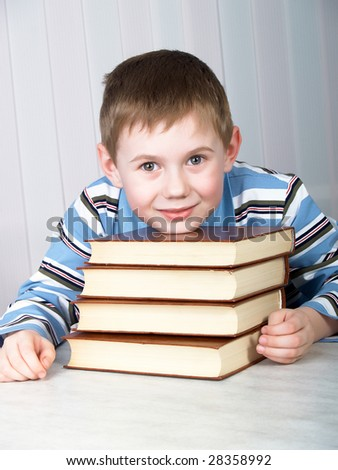 The child with books on the table