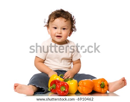 The child with paprika,isolated on a white background. - stock photo