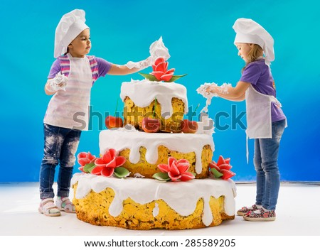 The children bake cake confectionery - stock photo