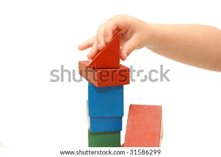 The children hand builds construction from cubes - stock photo