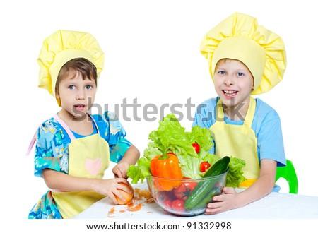 The children help prepare the cooks - stock photo