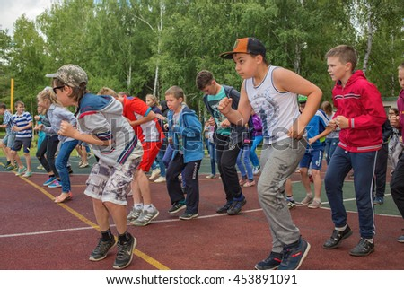The children in morning exercises at the camp. Editorial.  Russia. Yaroslavl region. 08.07.2016