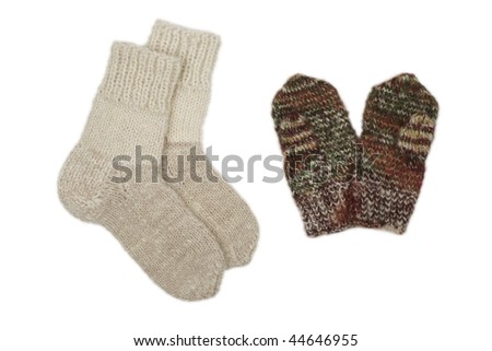 The children's socks knitting manually on knitting needles and mittens from a woolen yarn. Isolated on white. - stock photo