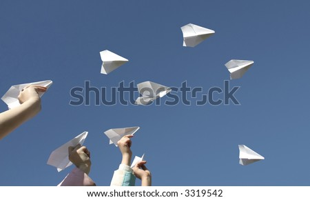 The Children throw skyward airplanes from paper. - stock photo