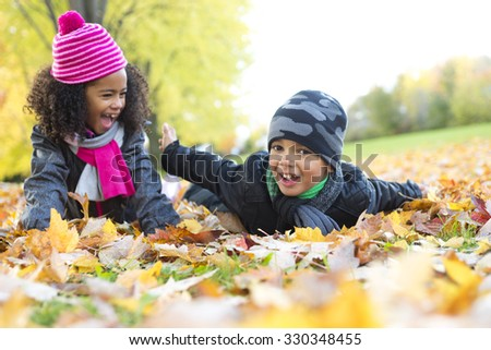The Childs on the leaf season. The autumn season - stock photo