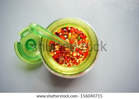 The chili sauce in the green cup