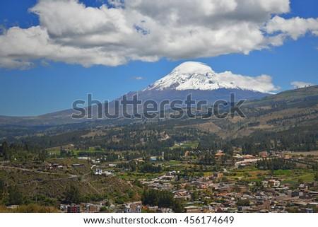 The Chimborazo volcano and the village of Guano, Ecuador.  - stock photo