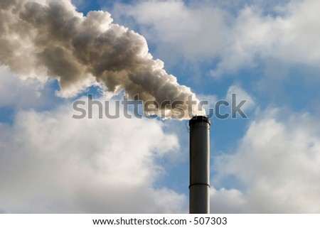 The chimney of a factory with white smoke