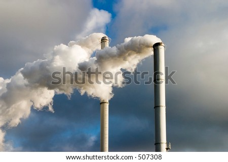 The chimney of a factory with white smoke - stock photo