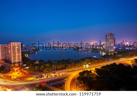 The Chinese city of Nanchang, Jiangxi Province, the road and the lake