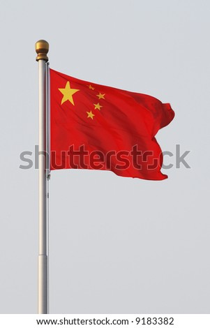 The Chinese flag fluttering over Tiananmen Square, Beijing. - stock photo
