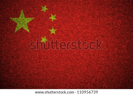 The Chinese flag painted on a cork board. - stock photo
