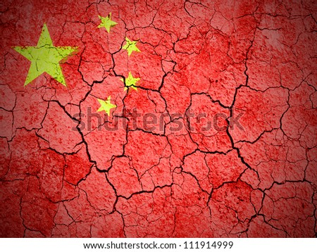 The Chinese flag painted on  cracked ground with vignette - stock photo