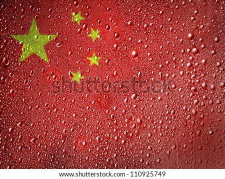 The Chinese flag painted on metal surface covered with rain drops - stock photo