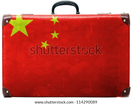 The Chinese flag painted on  old grungy travel suitcase or trunk - stock photo