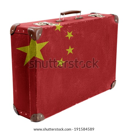 The Chinese flag painted on old grungy travel suitcase or trunk, side view - stock photo