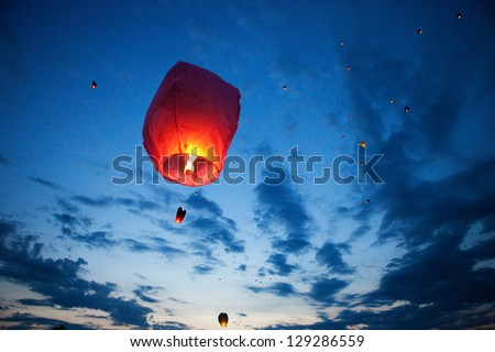 The Chinese lantern flies up highly in the sky. - stock photo