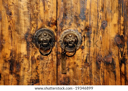The Chinese wood door with animal head background.