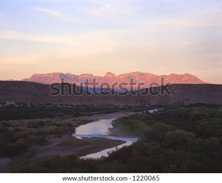 The Chisos Mountains of Big Bend National Park, in Texas, the Rio Grande River and the International Border with Mexico photographed in the early morning. - stock photo