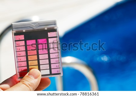 The chlorine content and pH are measured. Clean water in the pool - stock photo