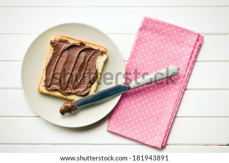 the chocolate spread with bread - stock photo